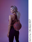 Young sportswoman with ball poses in studio. Стоковое фото, фотограф Tryapitsyn Sergiy / Фотобанк Лори