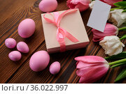 Pink tulips, easter eggs and gift box. Стоковое фото, фотограф Tryapitsyn Sergiy / Фотобанк Лори
