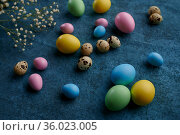 Easter eggs and wildflowers on blue background. Стоковое фото, фотограф Tryapitsyn Sergiy / Фотобанк Лори