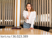 Young hispanic business woman stretching hand for handshake. Стоковое фото, фотограф Яков Филимонов / Фотобанк Лори