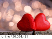 Two red wooden hearts symbol of love on background with beautiful... Стоковое фото, фотограф Zoonar.com/Ivan Mikhaylov / easy Fotostock / Фотобанк Лори