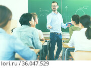 Male teacher giving lecture for students. Стоковое фото, фотограф Яков Филимонов / Фотобанк Лори