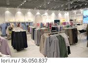 Summer clothing on hangers in clothing shop interior. Стоковое фото, фотограф Евгений Ткачёв / Фотобанк Лори
