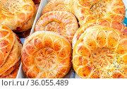 Fresh uzbek flat breads with sesame seeds from the tandir. Traditional... Стоковое фото, фотограф Zoonar.com/Alexander Blinov / easy Fotostock / Фотобанк Лори