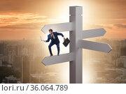 Businessman at the crossroads choosing strategy. Стоковое фото, фотограф Elnur / Фотобанк Лори