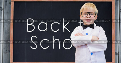 Composition of smiling schoolboy over white text back to school on chalkboard