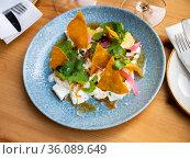 Salad in Mexican style with burrata, avocado, greens, corn chips. Стоковое фото, фотограф Яков Филимонов / Фотобанк Лори