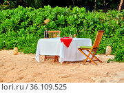 Table set up for romantic dinner on beach at Mahe, Seychelles. Стоковое фото, фотограф Zoonar.com/NIKOLAY OKHITIN / easy Fotostock / Фотобанк Лори