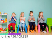 Children are sitting on the colorful chairs in the kindergarten. The... Стоковое фото, фотограф Zoonar.com/OKSANA SHUFRYCH / easy Fotostock / Фотобанк Лори