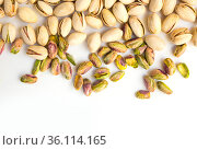roasted pistachio nuts on a white background and place for inscription. Стоковое фото, фотограф Татьяна Яцевич / Фотобанк Лори