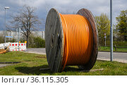 """Cable drum with fibre optic cable, broadband expansion, Rheinbach, Rhein-Sieg-Kreis, North Rhine-Westphalia, Germany"" Редакционное фото, агентство Caro Photoagency / Фотобанк Лори"