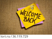 Welcome back - handwriting on a sticky note, business reopening concept... Стоковое фото, фотограф Zoonar.com/Marek Uliasz / easy Fotostock / Фотобанк Лори