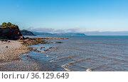 The beach in Watchet, Somerset, England, UK - with Minehead in the... Стоковое фото, фотограф Zoonar.com/Bernd Brueggemann / easy Fotostock / Фотобанк Лори