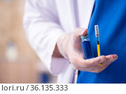 Young male doctor in vaccination concept. Стоковое фото, фотограф Elnur / Фотобанк Лори