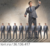 Boss employee manipulating his staff in business concept. Стоковое фото, фотограф Elnur / Фотобанк Лори