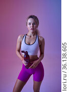 Young sexy sportswoman drinks water in studio. Стоковое фото, фотограф Tryapitsyn Sergiy / Фотобанк Лори