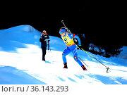 Dorothea Wierer (Italien) im Anstieg zur Huber Alm bei der IBU Biathlon... Стоковое фото, фотограф Zoonar.com/Joachim Hahne / age Fotostock / Фотобанк Лори