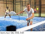 Man playing padel tennis on padel court. Стоковое фото, фотограф Яков Филимонов / Фотобанк Лори