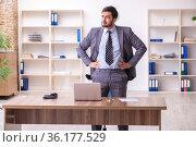 Young handsome businessman employee in bunkruptcy concept. Стоковое фото, фотограф Elnur / Фотобанк Лори