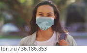 Portrait of asian woman wearing face mask with backpack standing on the road. Стоковое видео, агентство Wavebreak Media / Фотобанк Лори