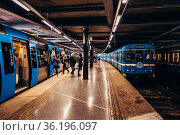 Editorial 03.27.2019 Stockholm Sweden. Passengers stepping out from... Стоковое фото, фотограф Zoonar.com/Janus Orlov / age Fotostock / Фотобанк Лори
