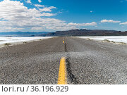 Lower angle of an empty road with some mountains on the horizon surrounded... Стоковое фото, фотограф Marquicio Pagola / age Fotostock / Фотобанк Лори