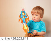 Toddler play astronaut and rocket liftoff. Стоковое фото, фотограф Сергей Новиков / Фотобанк Лори