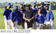 Group portrait of diverse team of female baseball players and coach in face masks on sunny pitch. Стоковое видео, агентство Wavebreak Media / Фотобанк Лори
