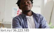 Portrait of african american male artist with arms crossed at art studio. Стоковое видео, агентство Wavebreak Media / Фотобанк Лори