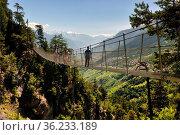 Bisse du Torrent Neuf or Bisse de Savièse - Cliffside walk and suspension... Стоковое фото, фотограф Danuta Hyniewska / age Fotostock / Фотобанк Лори
