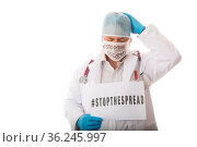 Overwhelmed doctor advising to STOP THE SPREAD of infectious virus... Стоковое фото, фотограф Zoonar.com/Leah-Anne Thompson / easy Fotostock / Фотобанк Лори