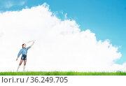 Adorable little girl holding a paper plane outdoors on green grass. Стоковое фото, фотограф Zoonar.com/Aleksandr Khakimullin / easy Fotostock / Фотобанк Лори