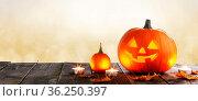 Magic halloween pumpkins and burning candles on golden bokeh lights... Стоковое фото, фотограф Zoonar.com/Ivan Mikhaylov / easy Fotostock / Фотобанк Лори