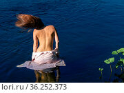 Young woman swimming in the river without a swimsuit. Стоковое фото, фотограф Евгений Харитонов / Фотобанк Лори