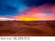 Beatiful landscape with dramatic sunset in desert. Стоковое фото, фотограф Zoonar.com/Kokhanchikov / easy Fotostock / Фотобанк Лори
