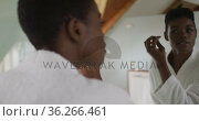 African american attractive woman taking care of face in bathroom. Стоковое видео, агентство Wavebreak Media / Фотобанк Лори