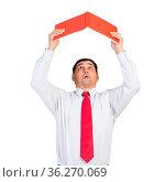 Senior businessman holding open book overhead. Portrait of adult man... Стоковое фото, фотограф Zoonar.com/Aleksandr Khakimullin / easy Fotostock / Фотобанк Лори