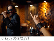 Singer at microphone, music performing on stage. Стоковое фото, фотограф Tryapitsyn Sergiy / Фотобанк Лори