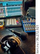 Headphones on the table, recording studio interior. Стоковое фото, фотограф Tryapitsyn Sergiy / Фотобанк Лори