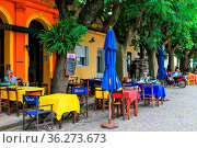 Street cafe in Colonia del Sacramento, Uruguay. It is one of the ... Стоковое фото, фотограф Zoonar.com/Don Mammoser / age Fotostock / Фотобанк Лори