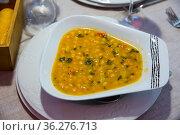 Garbanzo bean soup on a white plate. Стоковое фото, фотограф Яков Филимонов / Фотобанк Лори