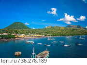 Boats in the bay of Labuhan Bajo - fishing town located at the western... Стоковое фото, фотограф Zoonar.com/Pawel Opaska / easy Fotostock / Фотобанк Лори