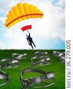 The businessman falling into trap on parachute. Стоковое фото, фотограф Zoonar.com/Elnur Amikishiyev / easy Fotostock / Фотобанк Лори