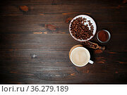 Coffee cup, coffee beans and ground powder on wooden background. Copy... Стоковое фото, фотограф Zoonar.com/Alex Veresovich / easy Fotostock / Фотобанк Лори
