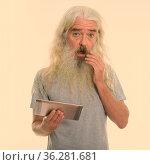 Studio shot of handsome senior man with long white curly beard and... Стоковое фото, фотограф Zoonar.com/Toni Rantala / easy Fotostock / Фотобанк Лори