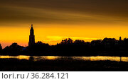 Skyline of the city of Rhenen during sunset with Cunera church and... Стоковое фото, фотограф Zoonar.com/Hilda Weges / easy Fotostock / Фотобанк Лори