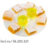 Pieces of Tarta de Santiago cake served for two with wine. Стоковое фото, фотограф Яков Филимонов / Фотобанк Лори