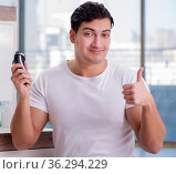 Young handsome man shaving in the morning. Стоковое фото, фотограф Elnur / Фотобанк Лори