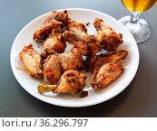 Appetizing baked chicken wings in plate closeup. Стоковое фото, фотограф Яков Филимонов / Фотобанк Лори