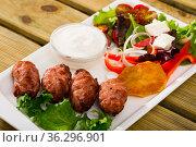 Dish of Bulgarian cuisine Kebapche. Стоковое фото, фотограф Яков Филимонов / Фотобанк Лори